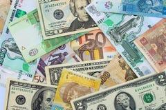 Pengar från olika landsdollar, euro, hryvnia, rubel Arkivbilder