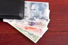 Pengar från Spanien i den svarta plånboken