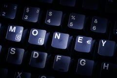 pengar för datortangentbord Arkivfoto
