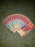 Pengar hundra pund Arkivbilder