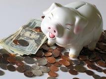 Pengar i banken, spargrisen arkivfoton