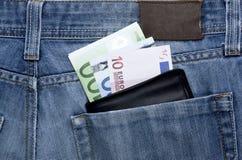 Pengar i fick- Arkivbilder