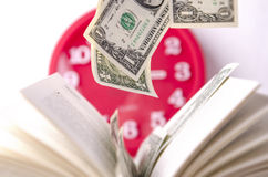 Pengar i en öppen bok Royaltyfria Bilder