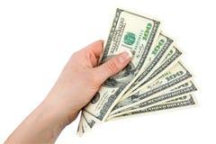 Pengar i en geende hand Arkivbilder