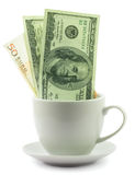 Pengar i en kopp Fotografering för Bildbyråer