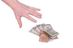 Pengar i en mousetrap Arkivbild