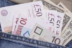 Pengar i ett fack royaltyfri foto