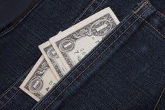 Pengar i ett fack royaltyfri bild