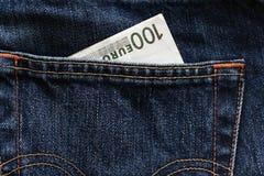 Pengar i ett fick- Fotografering för Bildbyråer