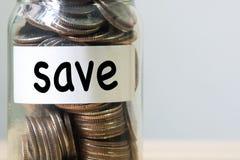 Pengar i exponeringsglaset med texträddning, kopieringsutrymme Royaltyfria Foton