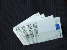 Pengar i fack Arkivfoton