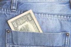 Pengar i fack Arkivbild