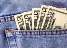 Pengar i facket Arkivbild