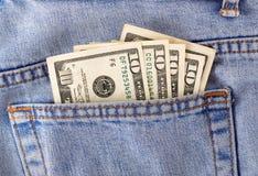 Pengar i facket Arkivbilder