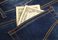 Pengar i facket av jeans Royaltyfria Bilder