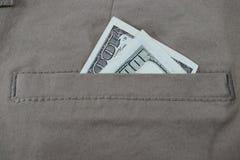 Pengar i flåsanden stoppa i fickan, dollar i jeansfack Fotografering för Bildbyråer