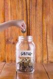 Pengar i glass mycket av mynt Royaltyfri Bild