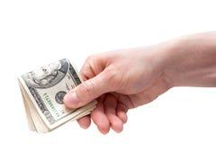 Pengar i hand Arkivbild
