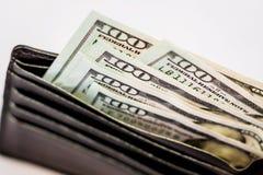 Pengar i handväskan för framställning av köp En handväska med dollar som Royaltyfria Foton