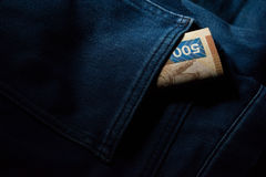 Pengar i jeansfack Royaltyfri Bild