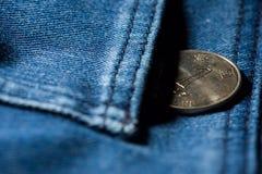 Pengar i jeansfack Arkivfoto