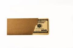 Pengar i kuvert Arkivfoto