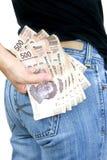 Pengar i mitt fack! Arkivfoton