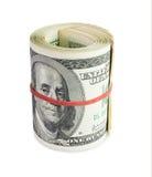 Pengar i rulle Arkivfoto