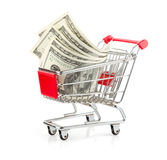 Pengar i shoppingvagn Royaltyfri Bild