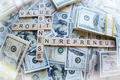 Pengar med entreprenören Basics High Quality royaltyfria foton
