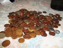 pengar myntar encentmyntUSA-dollar Arkivfoton