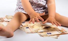 Pengar och barn Arkivbilder