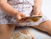 Pengar och barn Royaltyfri Bild