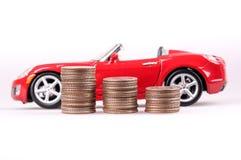 Pengar och bil Arkivfoton