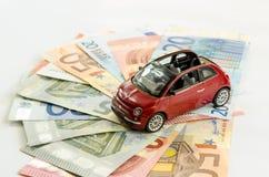 Pengar- och bilbegrepp Arkivbild