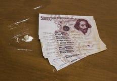Pengar och coca Royaltyfri Bild