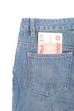 Pengar och jeans Arkivbild