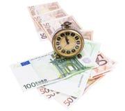 Pengar och klocka Fotografering för Bildbyråer