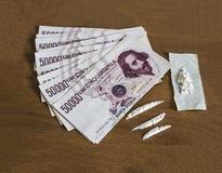Pengar och kokain Royaltyfria Foton