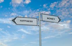 Pengar och lycka arkivbilder