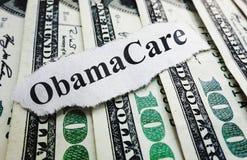 Pengar- och Obama omsorg Arkivfoto
