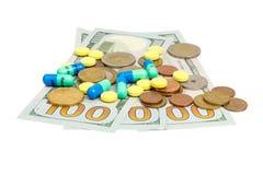 Pengar och pills Royaltyfri Foto