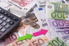 Pengar och räknemaskin Arkivfoton