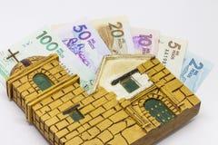 Pengar och religion royaltyfri foto