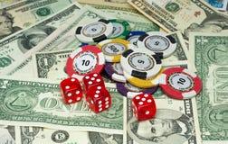 Pengar och riskerar Royaltyfri Bild