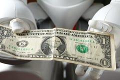 Pengar och robot Royaltyfria Bilder