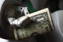 Pengar och robot Arkivfoto