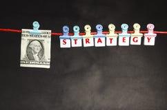 Pengar och strategi Arkivbild