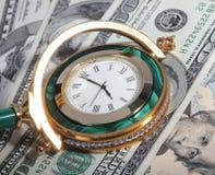 Pengar och Tid Royaltyfria Bilder