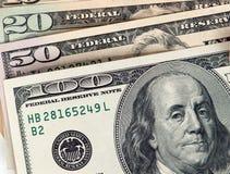 Pengar - olik US-valuta Arkivbild